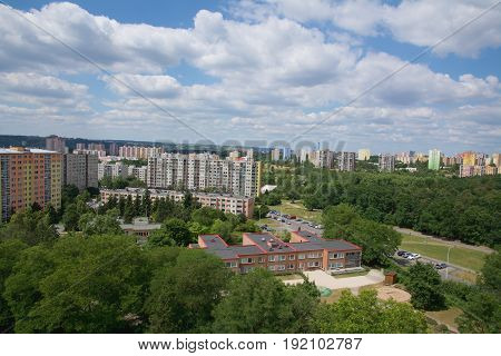 Old prefabricated housing estates in the outskirts of the town near a forest