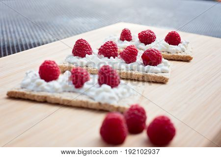 Crunchy Rye-wheat Bread With White Cottage Cheese And Raspberries