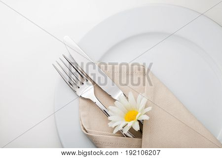 Place setting closeup cutlery tableware dish eating utensils close-up