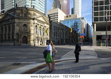 TORONTO,CANADA-AUGUST 2,2015:People waiting to cross the street in the Toronto suburbs during a sunny day.