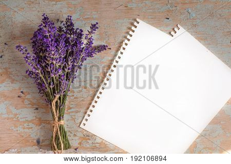 bunch of lavander on old wooden background. Space for text.