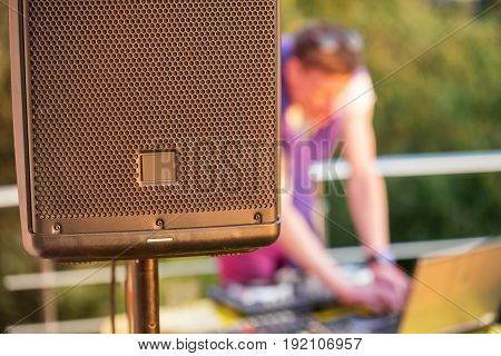 Dj mixing music outdoor. DJ mix the sound on the control panel