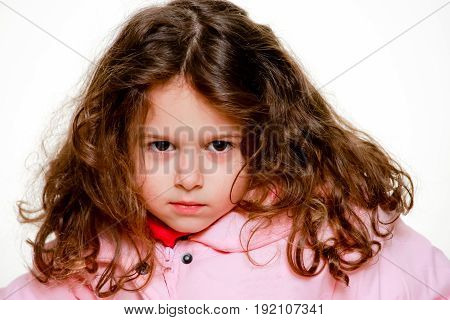 Potrait of curly hair little girl in studio