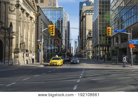 TORONTO,CANADA-AUGUST 2,2015:Traffic in the street of the Toronto suburbs during a sunny day.