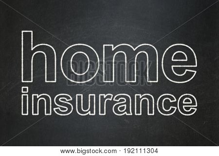 Insurance concept: text Home Insurance on Black chalkboard background