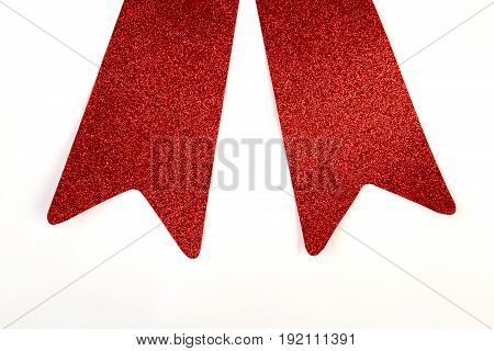 Two ribbon ends, white background. Cropped icon of red bow.