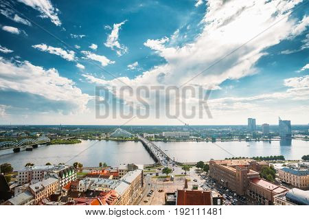 Riga, Latvia - July 1, 2016: Traffic On Akmens Tilts - Stone Bridge Street In Summer Day. Top View, Aerial View Of National Library Building, Named Castle of Light Or Gaismas Pils. Famous Landmark On Daugava Bank