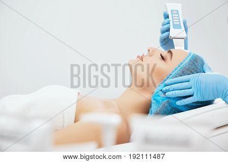 Woman On Procedure Of Ultrasonic Peeling