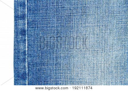 Piece of light blue jeans fabric isolated on white background.
