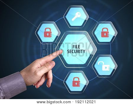 Business, Technology, Internet And Network Concept. Young Businessman Shows The Word: File Security