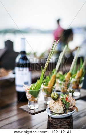gourmet tapas snack food in sophisticated modern outdoor bar at sunset