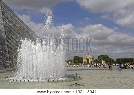 Paris, France, June 16, 2017 : The Arc De Triomphe Du Carrousel And Tuileries Gardens Seen From The