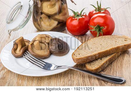 Jar With Marinated Mushroom, Tomatoes, Plate With Lactarius, Bread