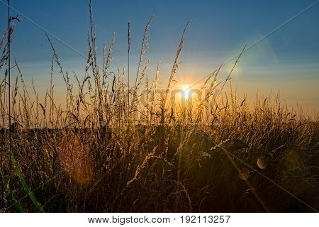 The Sundown over a field at a village in Germany