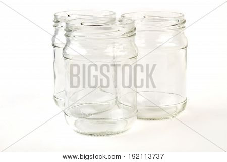 Closeup jars for jam isolated. Glassware containers on white background.