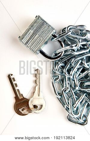 Closeup of iron chain with padlock. Iron security equipment, top view.