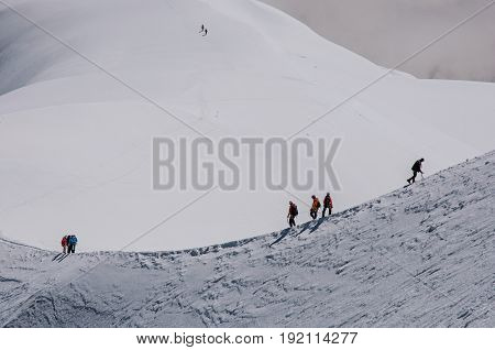 View of climbers from the Aiguille du Midi, in French Alps Chamonix Mont Blanc, alpine mountains landscape, clear blue sky in warm sunny summer day