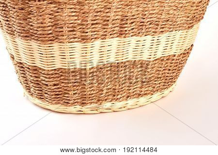 Cropped image of woven basket. Natural wooden basket, retro style.