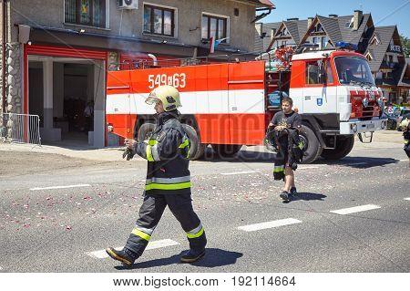 Bialka Tatrzanska, Poland - June 15, 2017: Firefighters Rush To Respond To Emergency Call During Cor