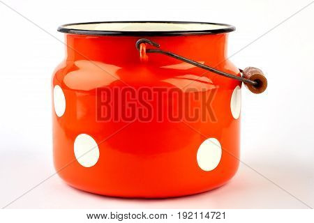 Enameled kitchen cookware isolated. Jug for milk with aluminum holder, white background.