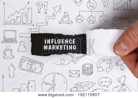 Business, Technology, Internet And Network Concept. Young Businessman Shows The Word: Influence Mark