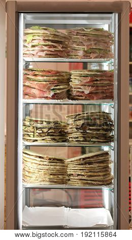 Refrigerator With Lots Of Stuffed Sandwiches Called Spianata Or