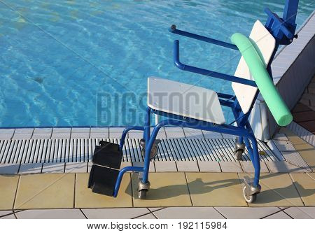Special Wheelchair To Enter The Pool For Rehabilitative Gymnasti
