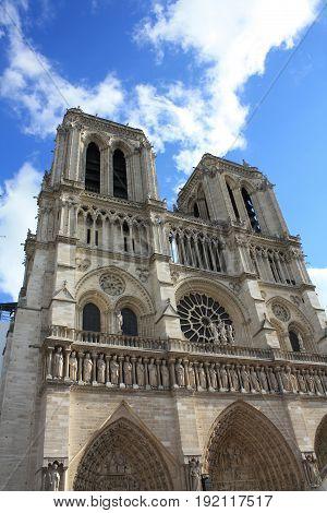 Cathedral Notre Dame de Paris facade on the sky