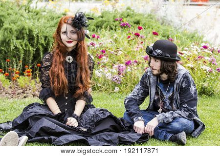 CAGLIARI, ITALY - JUNE 1, 2014: Sunday at the Great Jatte Public Gardens - Pair of young people wearing a Victorian-style costume - Sardinia