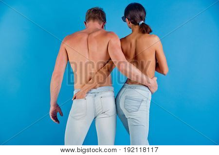 Couple Of Man And Woman Embrace In Stylish Jeans