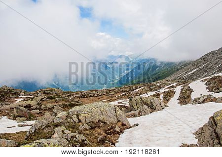 View of the Chamonix Valley from the Plan de L'Aiguille (intermediate landing on the ascent by cable cars to the Aiguille du Midi), French Alps Chamonix Mont Blanc, mountains landscape, cloudy weather