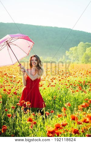 Girl In Field Of Poppy Seed With Umbrella