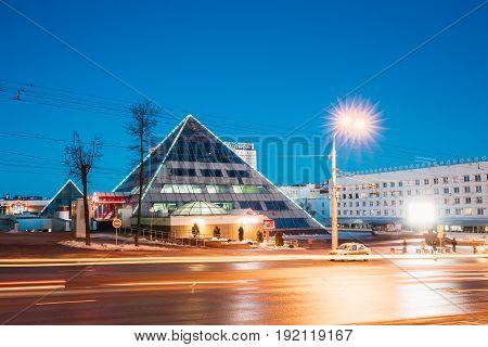 Vitebsk, Belarus - February 15, 2017: Shops In Pyramid Shape In Lenin Street At Winter Season. View From Gogol Street In Evening Or Night Illumination In Vitebsk, Belarus