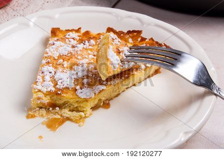 Slice Of Homemade Apple Pie And Fork On Light Marble Background