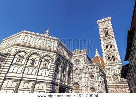 Piazza del Duomo in Florence Italy with the Basilica di Santa Maria del Fiore Giotto's Campanile and the Baptistery of San Giovanni