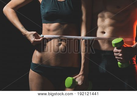 Couple Of Sexy Woman And Athletic Man With Dumbbell