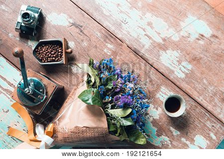 top view of ground coffee pouring water on coffee ground with filter Flower and wood background Colour Retro style. Copy space for your text. Thailand