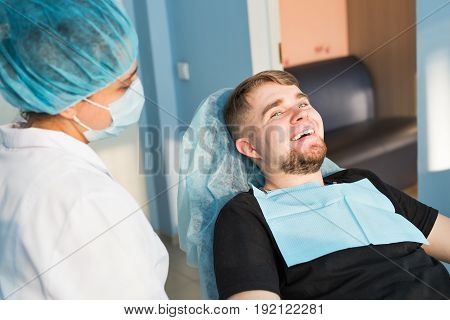 Woman dentist works in the medical dental office