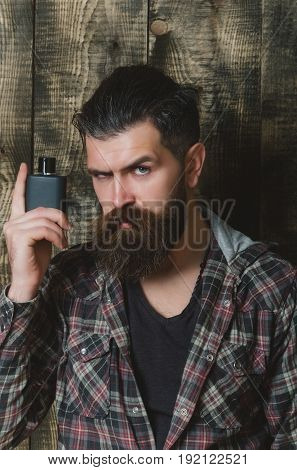 Man Posing With Black Perfume Or Cologne Bottle