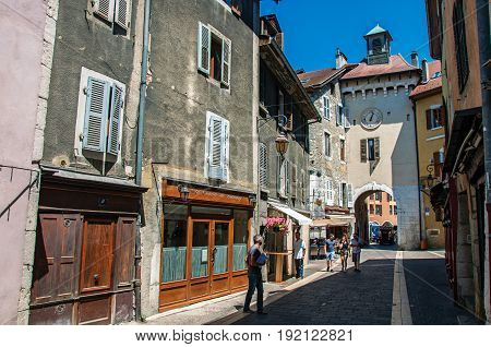 Annecy, France - June 28, 2016. Street with old buildings and people in the city center of Annecy, a historic city in the department of Haute-Savoie, Auvergne-Rhône-Alpes region, south-eastern France