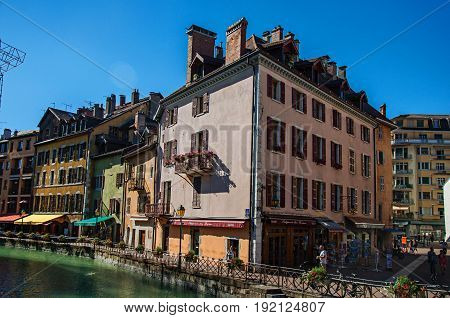 Annecy, France - June 28, 2016. Facade of old and colorful buildings facing the canal, city center of the historic Annecy, department of Haute-Savoie, Auvergne-Rhône-Alpes region, south-eastern France