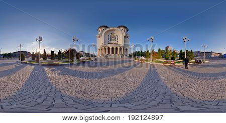 ARAD, ROMANIA - April 24: 360 panorama shot in front the entrance of the Holy Trinity Orthodox Cathedral at sunset in Arad, Romania
