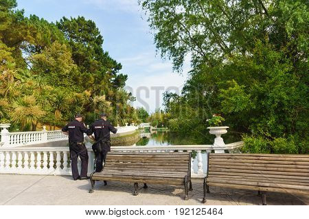 Two Police Officers Guarding The Order Around The Pond In The Dendrological Park