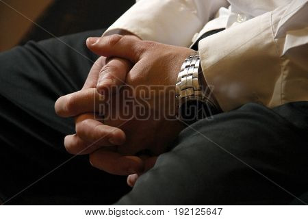 Male Hands Of A Businessman In A Castle On His Knees. Waiting For A Meeting, Recruitment, Recruiting