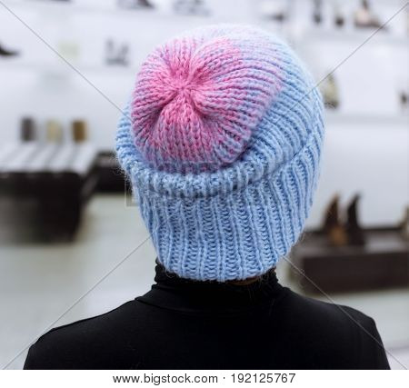Hat with knitted Welt turned manually with a gradient of blue and pink wool