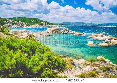 Costline of Costa Serena with sandstone rocks in sea, Sardinia, Italy.
