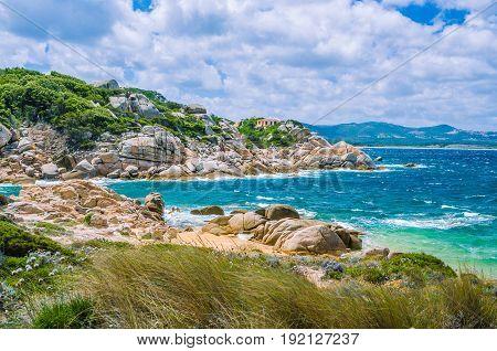 Windy costline with granite rocks near Costa Serena, Sardinia, Italy.