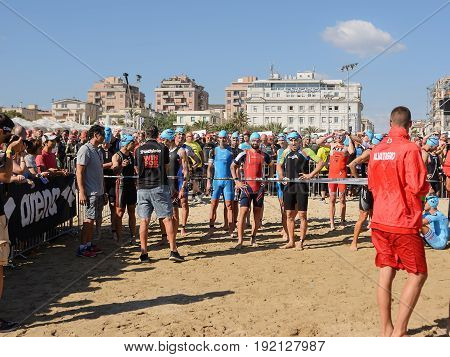 Pescara; Italy - June 18; 2017: Professional athletes on the starting line at Ironman 70.3 Pescara of June 18; 2017