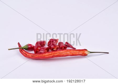 Chili pepper in a cut on a white background