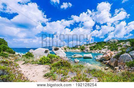 Cala Scilla place near Costa Serena with sandstone rocks in sea, Sardinia, Italy. Banner